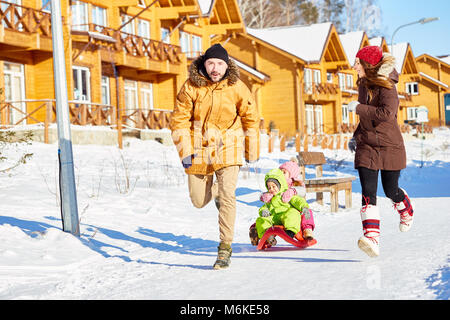 Family having fun in winter - Stock Photo