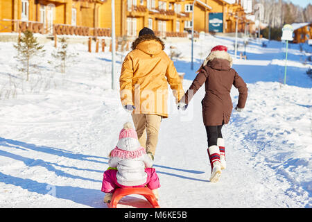 Active family on winter weekend - Stock Photo