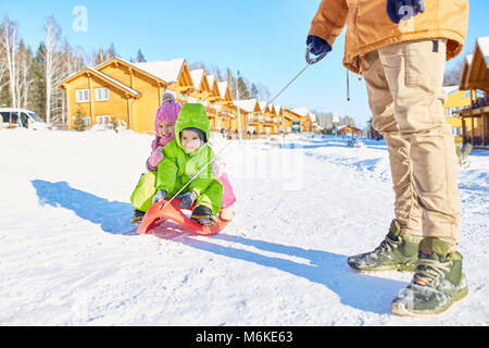Children enjoying sleigh ride - Stock Photo