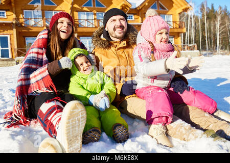 United family on winter weekend - Stock Photo