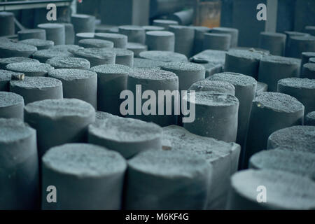 Rows of Graphite Manufactured Articles - Stock Photo
