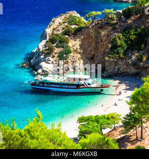 Beautiful Apella beach,view with azure sea and boat,Karpathos island,Greece. - Stock Photo