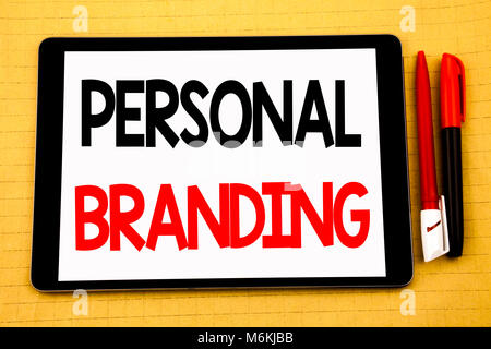 Conceptual handwriting text caption inspiration showing Personal Branding. Business concept for Brand Building Written on tablet, wooden background wi