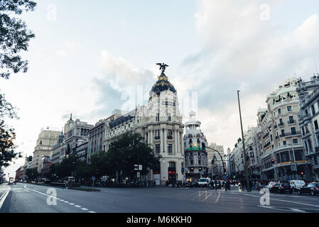 Madrid, Spain - November 3, 2017:  Gran Via street and Metropolis Building in Madrid at sunset. - Stock Photo