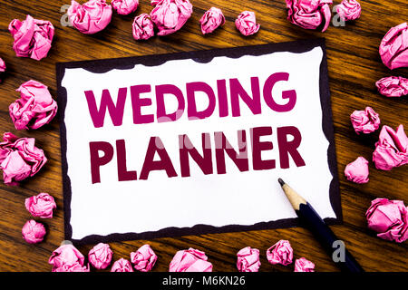 Hand writing text caption inspiration showing Wedding Planner. Business concept for Marriage Preparation Written - Stock Photo