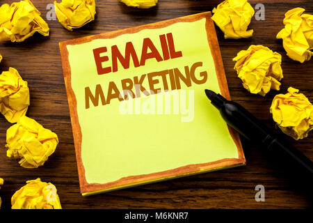 Hand writing text caption showing Email Marketing. Business concept for Online Web Promotion Written on sticky note - Stock Photo