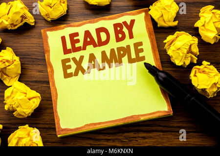 Hand writing text caption showing Lead By Example. Business concept for Motivation Inspiration Written on sticky - Stock Photo