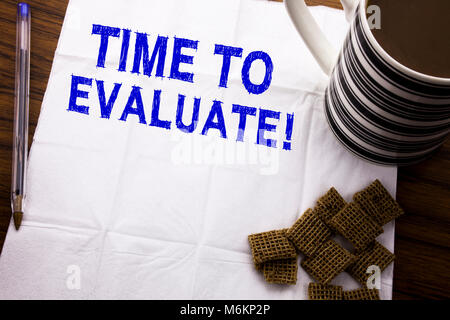 Hand writing text caption showing Time To Evaluate. Business concept for Assessment Evaluation written on tissue - Stock Photo