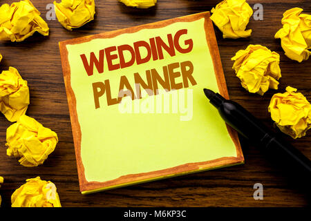 Hand writing text caption showing Wedding Planner. Business concept for Marriage Preparation Written on sticky note - Stock Photo