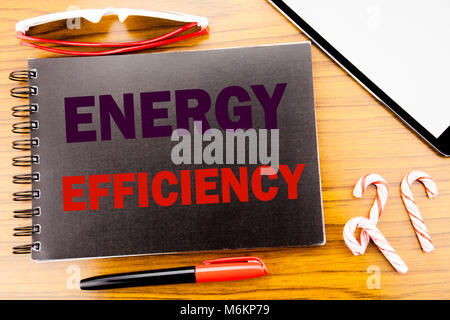 Handwriting Announcement text   Energy Efficiency. Business concept for Electricity Ecology Written on notepad notebook - Stock Photo