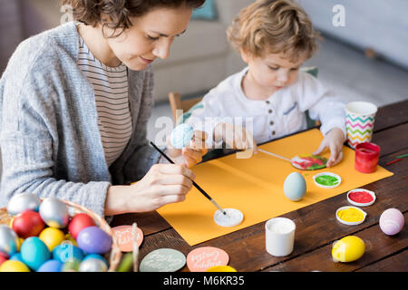 Family Painting Easter Eggs - Stock Photo