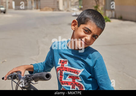 Kashan, Iran - April 27, 2017: A close-up portrait of an unknown Iranian boy, about 12 years old, who played outdoors. - Stock Photo