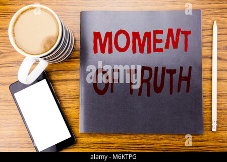Handwriting Announcement text showing Moment Of Truth. Business concept for Hard Decision Pressure Written on notepad - Stock Photo