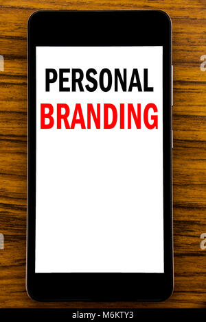 Handwriting Announcement text showing Personal Branding. Business concept for Brand Building Written on mobile cellphone with wooden background with s