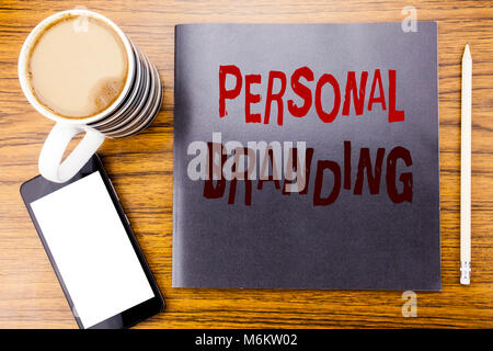 Handwriting Announcement text showing Personal Branding. Business concept for Brand Building Written on notepad note paper, wooden wood background cof