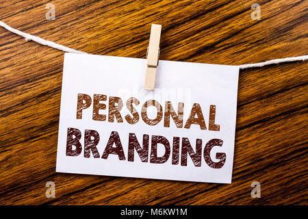 Handwriting Announcement text showing Personal Branding. Business concept for Brand Building written on sticky note paper on wooden background.
