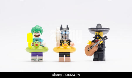 lego joker, batman with  mariachi playing a guitar. isolated on white backgorund. - Stock Photo