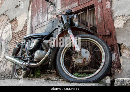 PENANG, MALAYSIA, NOV 12 2017, motorcycle with paint of boy on wall as Street Art in Georgetown, Penang. - Stock Photo