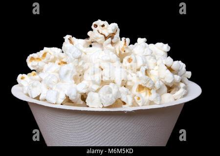 Popcorn in white bucket on black background, macro view. - Stock Photo