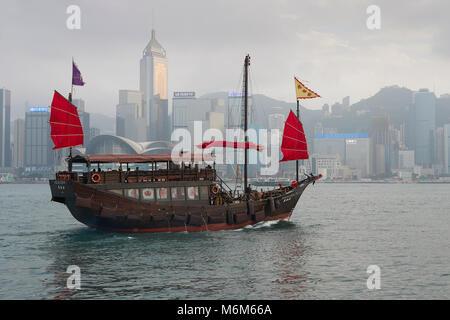 Aqualuna Harbour Cruise Crossing Victoria Harbour, Hong Kong. The Wan Chai Skyline Iin Background. - Stock Photo