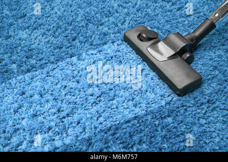 vacuum cleaner on the floor - Stock Photo