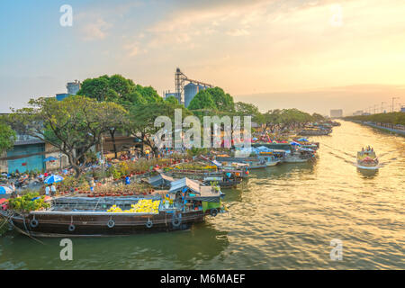 Boating along canal with apricot carry flowers, confetti, almond tree spring to sell everyone distillation - Stock Photo