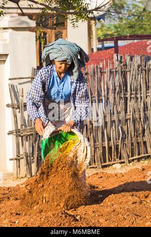 Villagers undertake manual road construction work at West Phwar Saw Village, Bagan, Myanmar (Burma), Asia in February - Stock Photo