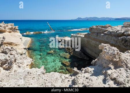 Clear turquoise sea and rock formations with ship wreck at Sarakiniko, Sarakiniko, Milos, Cyclades, Aegean Sea, - Stock Photo