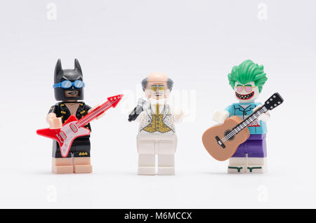 lego vacation batman and beach joker minifigure holding a guitar with alfred holding a microphone. isolated on white - Stock Photo