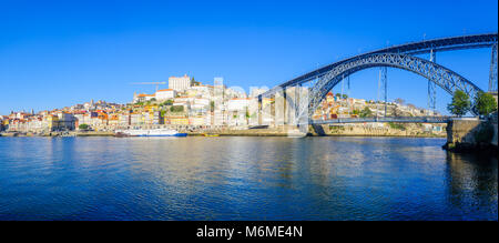 Panoramic view of the Dom Luis I Bridge, the Douro river and the Ribeira (riverside), with colorful buildings, in - Stock Photo