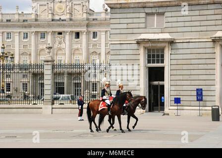 Guards on the horses at Royal Palace, Palacio Real, Madrid, Spain - Stock Photo
