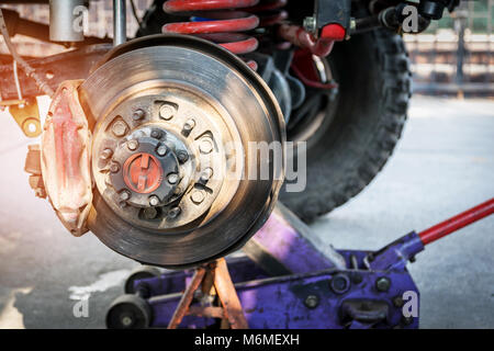 The front wheel of the car was removed to repair the brake system, Automotive industry and garage concepts. - Stock Photo