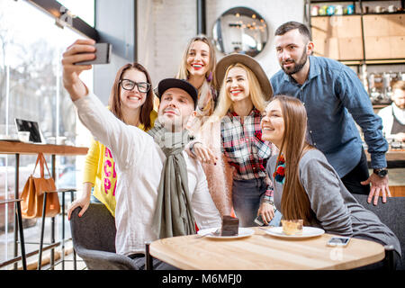 Friends in the cafe - Stock Photo