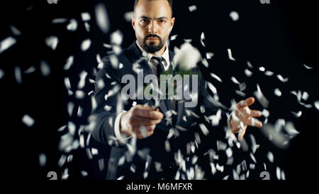 Professional Magician Performs Flower (Rose) Bud Disappearing and Appearing Spectacular Trick. The Background is - Stock Photo