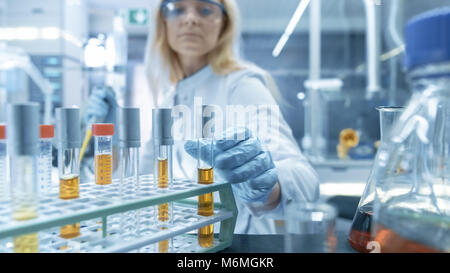 Shot of a Cart with Test-Tubes, Analysis, Beakers and Various Glassware. Scientist Takes Some of Test-Tubes for - Stock Photo