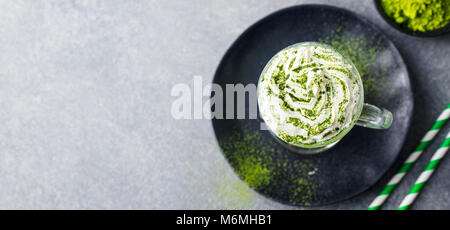 Matcha green tea latte with whipped cream. Top view. Copy space. - Stock Photo