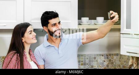 Beautiful Couple Takes Selfie - Stock Photo