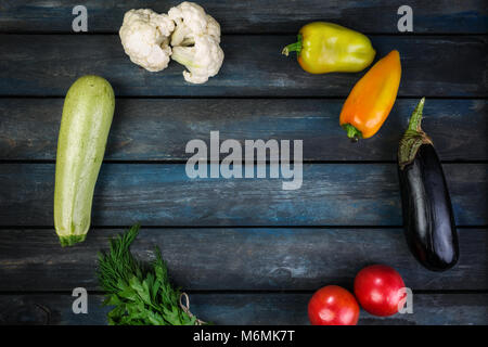 Ingredients for grilled vegetables salad with zucchini, eggplant, onions, peppers and tomato. Top view - Stock Photo