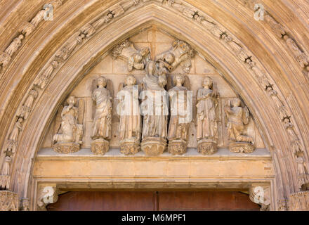 Group of statues over the Palau Door on the exterior of the Valencia cathedral, Spain - Stock Photo