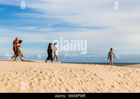 Punta Del Este, Uruguay - February 28th, 2018: People walking in the beach to visit La Mano, the sculpture made - Stock Photo