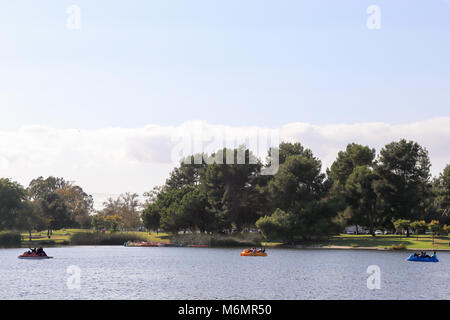 Pedal boating in a lake at El Dorado East Regional Park, Long Beach California on a sunny afternoon, - Stock Photo