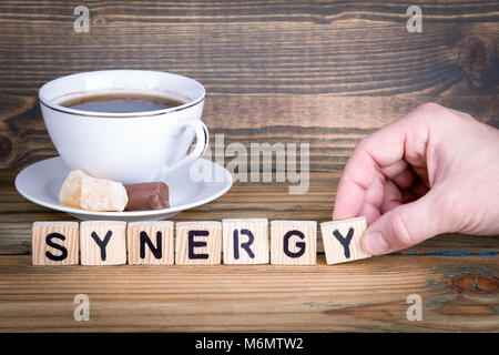 synergy. Wooden letters on the office desk, informative and communication background - Stock Photo