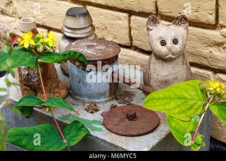 A collection of Winstanley pottery cats arranged outdoors. North Walsham, Norfolk, UK. - Stock Photo