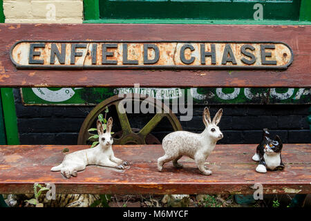 A collection of Winstanley pottery cats and rabbits arranged outdoors. North Walsham, Norfolk, UK. - Stock Photo