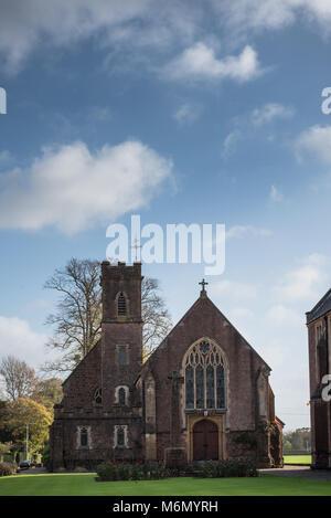 Blundell's School chapel under a blue sky - Stock Photo