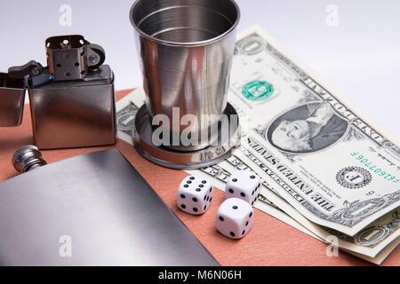alcohol flash cigard lighter matches zippo glass dice dollar bill wood texture - Stock Photo