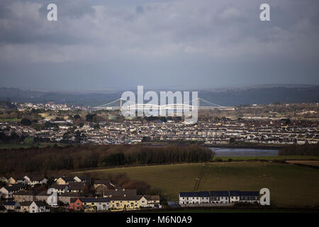 Tamar estuary looking towards Torpoint and The Tamar bridge with the Royal Albert Bridge designed by Isambard Kingdom - Stock Photo