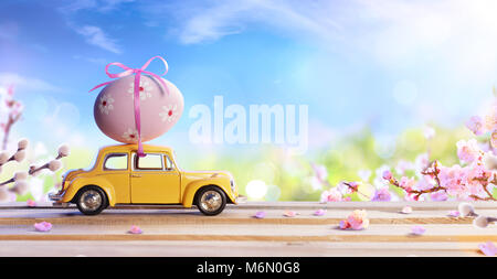 Deformed And Unrecognizable Car Carrying Easter Egg - Stock Photo