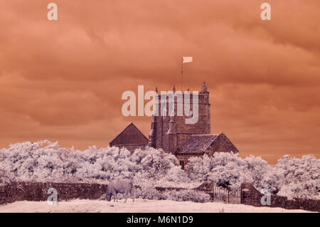 Infrared picture of the grade II listed, partially ruined 'Old church of St Nicholas' on top of Uphill Hill near - Stock Photo