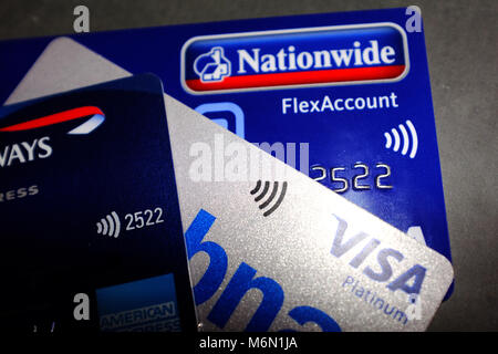Contactless symbols on Nationwide, MBNA and American Express Visa Debit and Credit cards. - Stock Photo